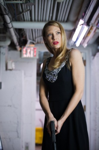 Anna Torv as Olivia Dunham wearing a dress.