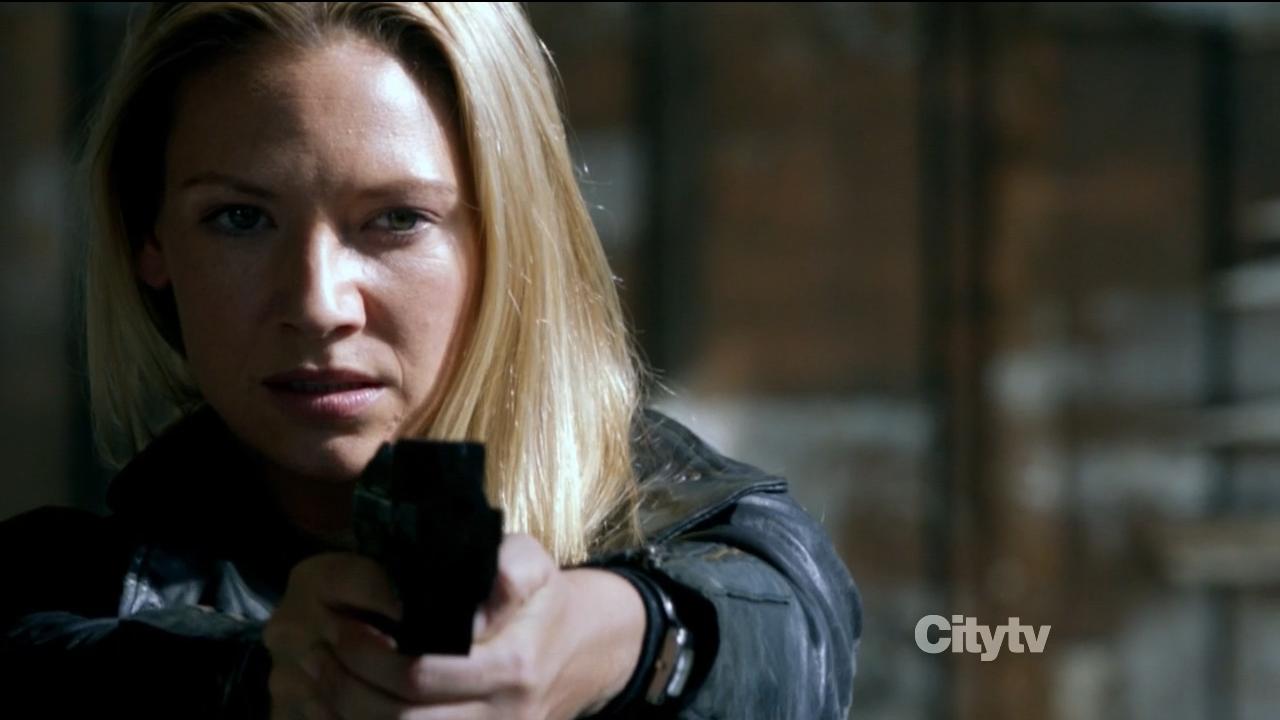 Olivia Dunham (Anna Torv) shooting an Observer - Fringe 'An Origin Story' Review
