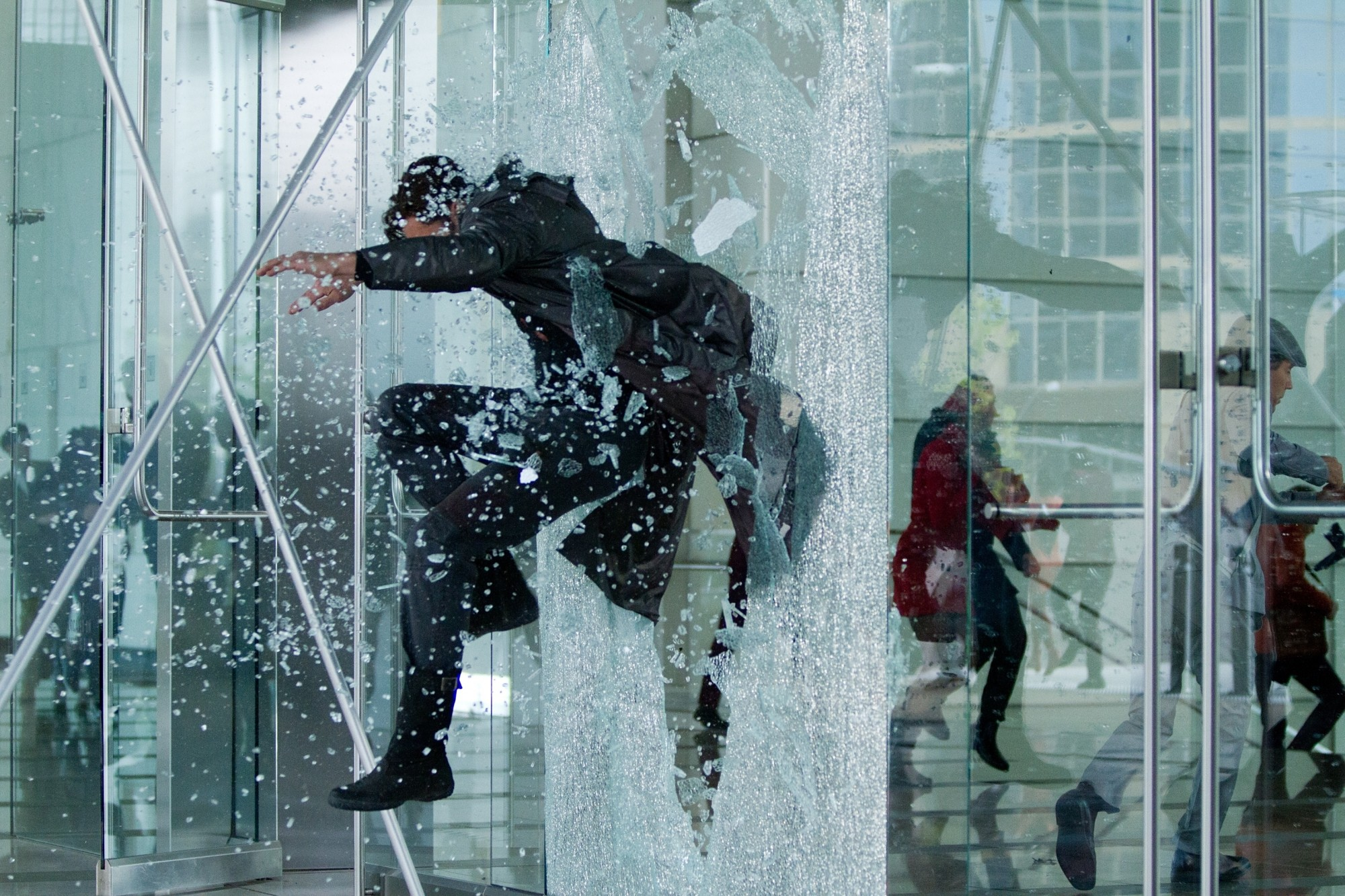 John Harrison leaping through a window