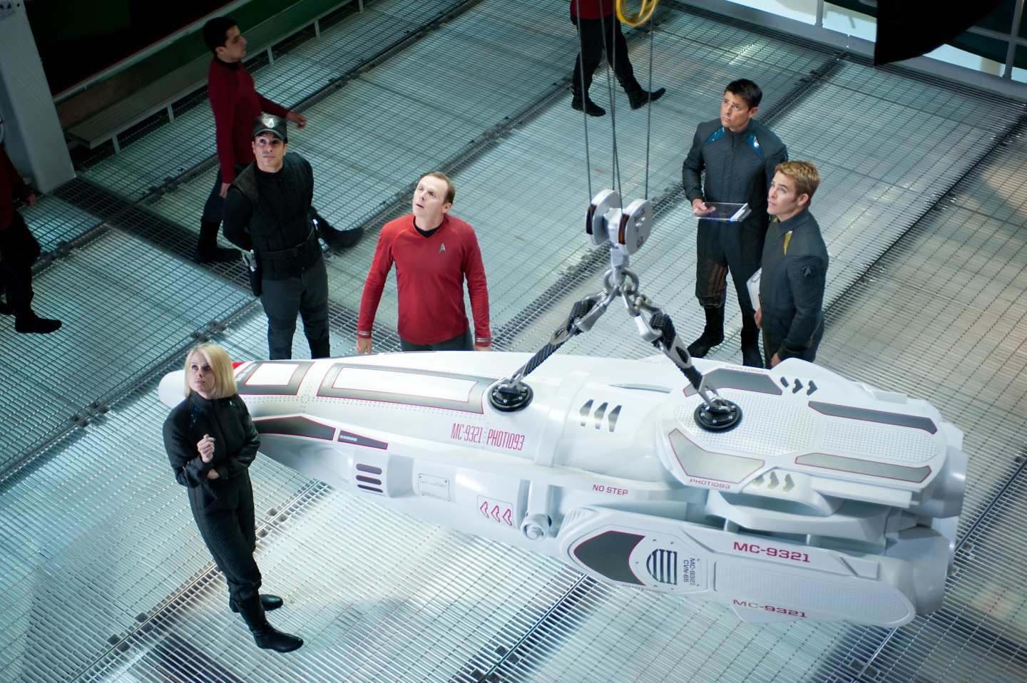 Alice Eve and Chris Pine with a capsule of some sorts - Star Trek Into Darkness
