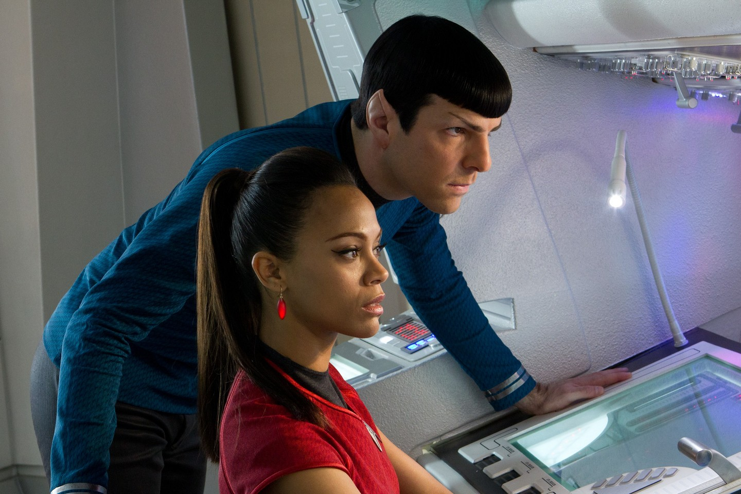 Zachary Quinto as Spock and Zoe Saldana as Uhura examining a console in Star Trek Into Darkness