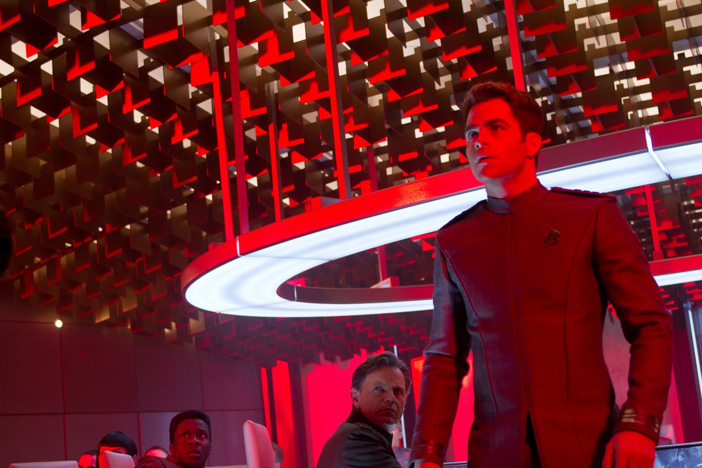 Chris Pine as Captain Kirk with Bruce Greenwood as Admiral Pike in the background in Star Trek Into Darkness