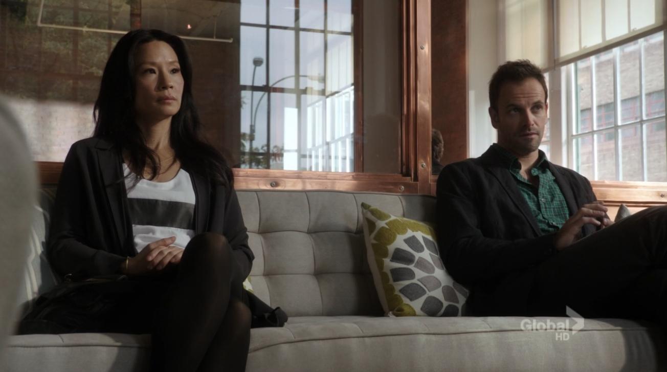 Lucy Liu as Joan Watson and Jonny Lee Miller as Sherlock - Elementary