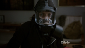 Agent Samantha Shaw (Sarah Shahi) wearing a gas mask - Person of Interest - Relevance