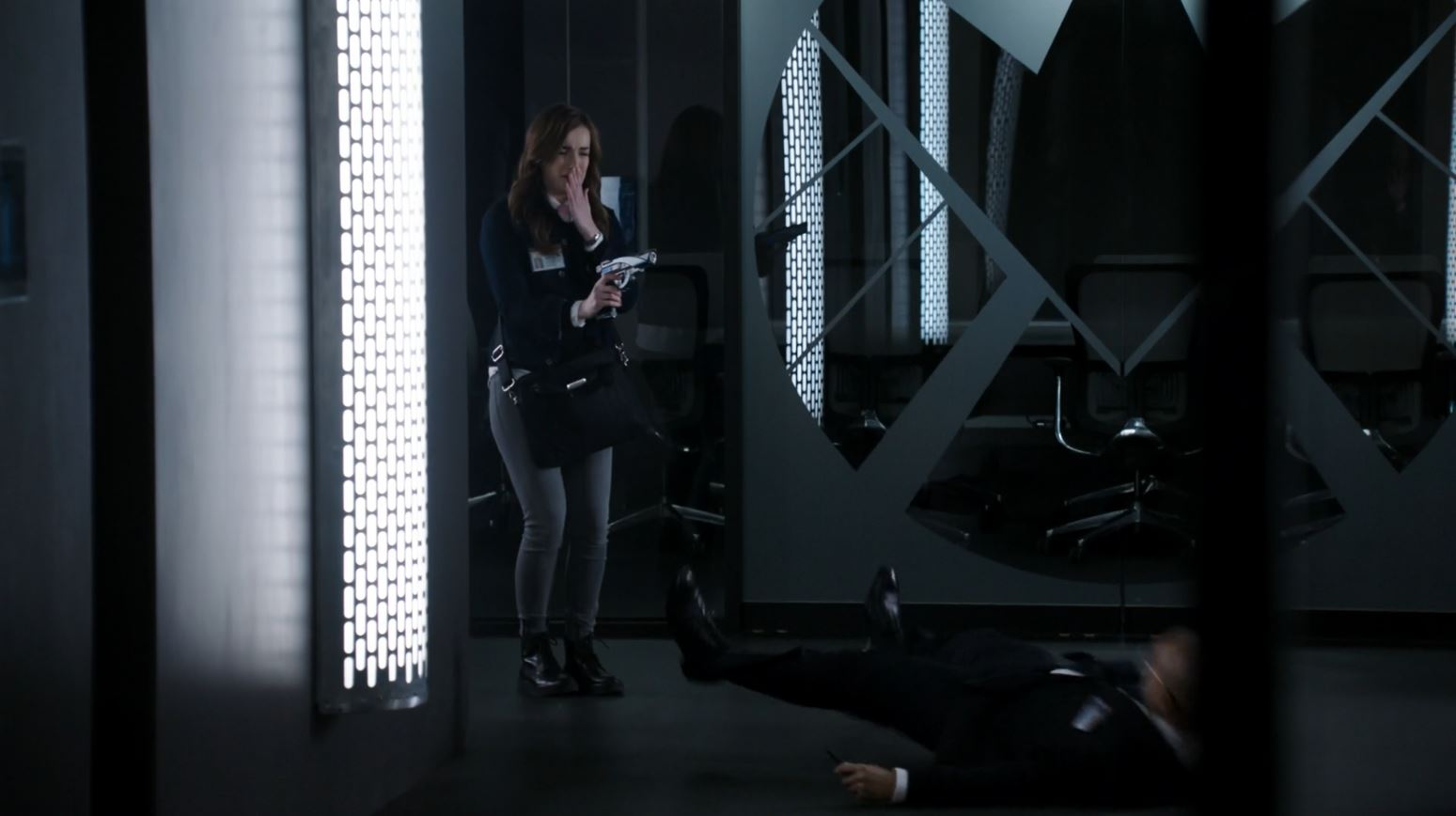 Elizabeth Henstridge as Jemma Simmons shoots a SHIELD agent - The Hub
