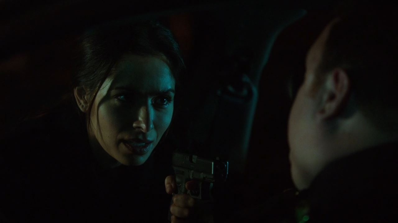 Sarah Shaw as Shaw questioning the corrupt cop