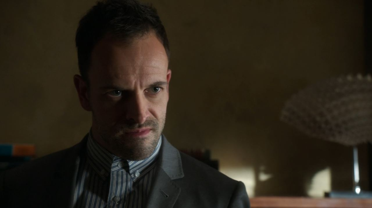 Elementary - Internal Audit - Jonny Lee Miller as Sherlock Holmes questioning Randy