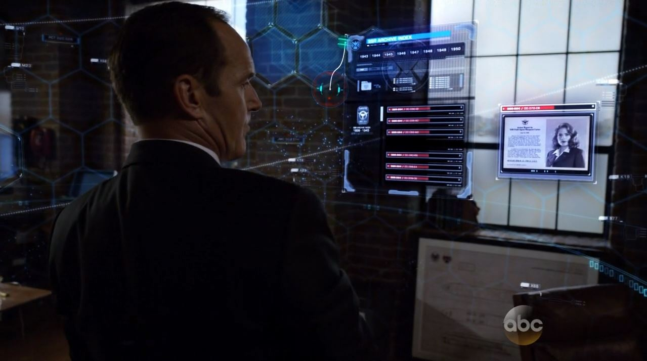 Agents of SHIELD S2Ep2 Heavy Is the Head Review - Coulson looking at old SHIELD files