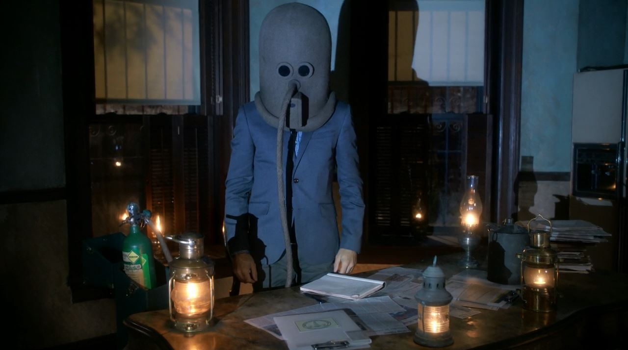 Sherlock (Jonny Lee Miller) wearing a gas mask - elementary s3ep1 review