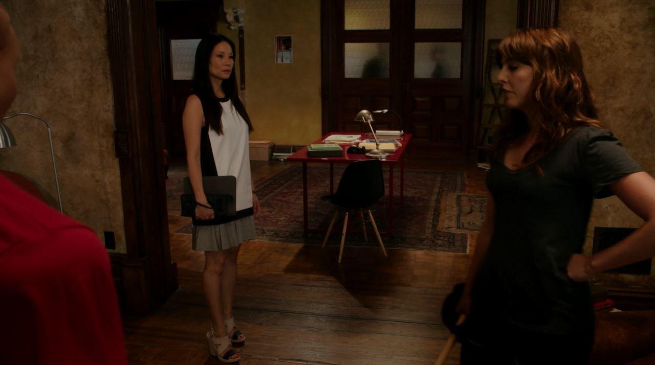 Joan Watson played by Lucy Liu wearing a tunic dress. Elementary Just a Regular Irregular Review