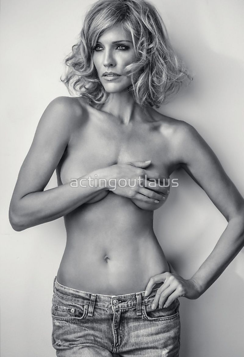 Tricia Helfer holding her boobs in 2015 Acting Outlaws Calendar