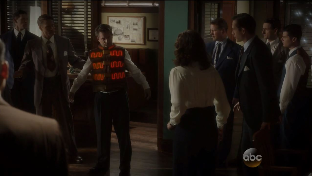 Agent Carter S1Ep7 SNAFU Review. Dooley wearing a bulletproof bombvest