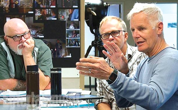 Chris Carter explaining something on set X-Files miniseries revival