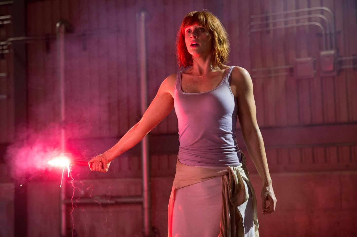 Claire Dearing (Bryce Dallas Howard) holding the red flare - Jurassic World Review