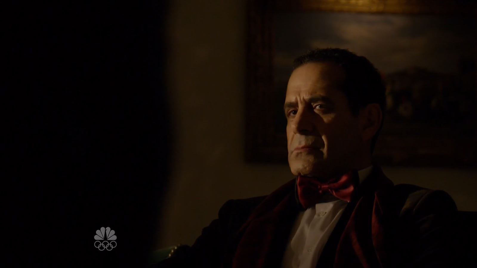 Alistair Pitt (Tony Shalhoub) listens to Reddington. The Blacklist S3Ep13 Alistair Pitt Review