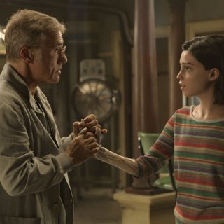 Christpoh Waltz as Dr. Dyson Ido talking to Alita in Alita Battle Angel