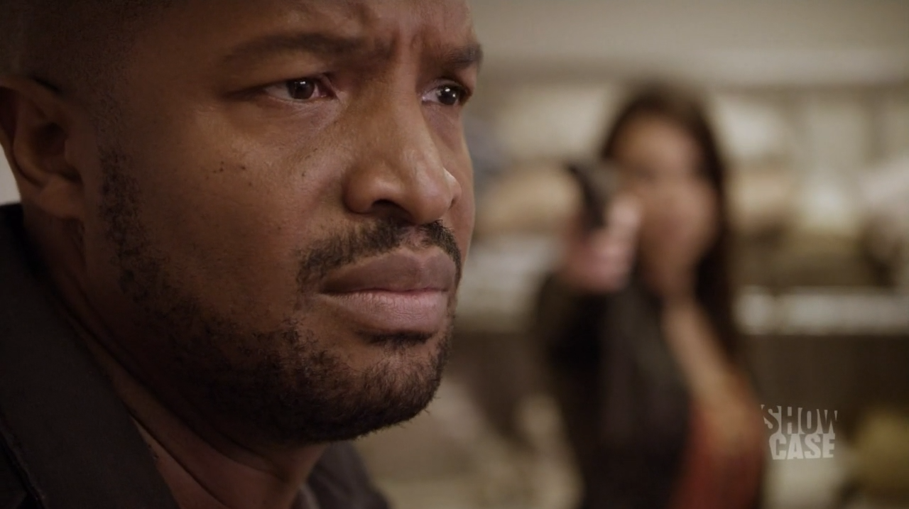 Travis Verta (Roger Cross) about to be shot by Sonya (Lexa Doig)