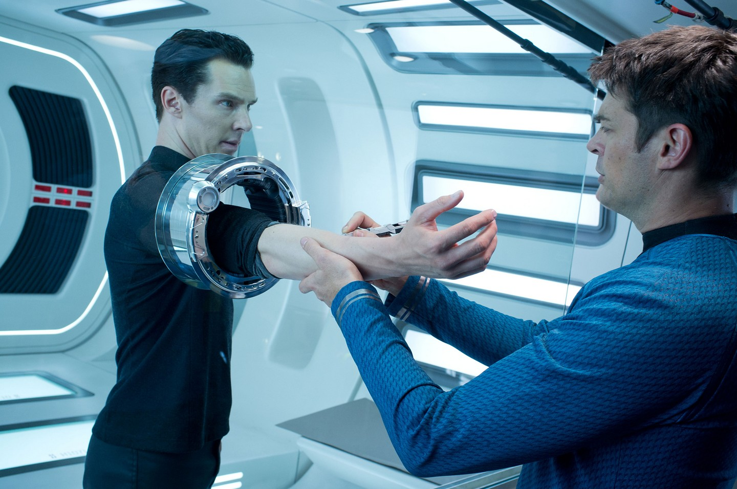Benedict Cumberbatch as John Harrison and Karl Urban as Doctor McCoy in Star Trek Into Darkness