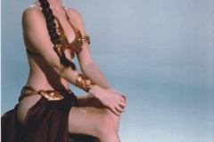 Slave Leia (Carrie Fisher) seated