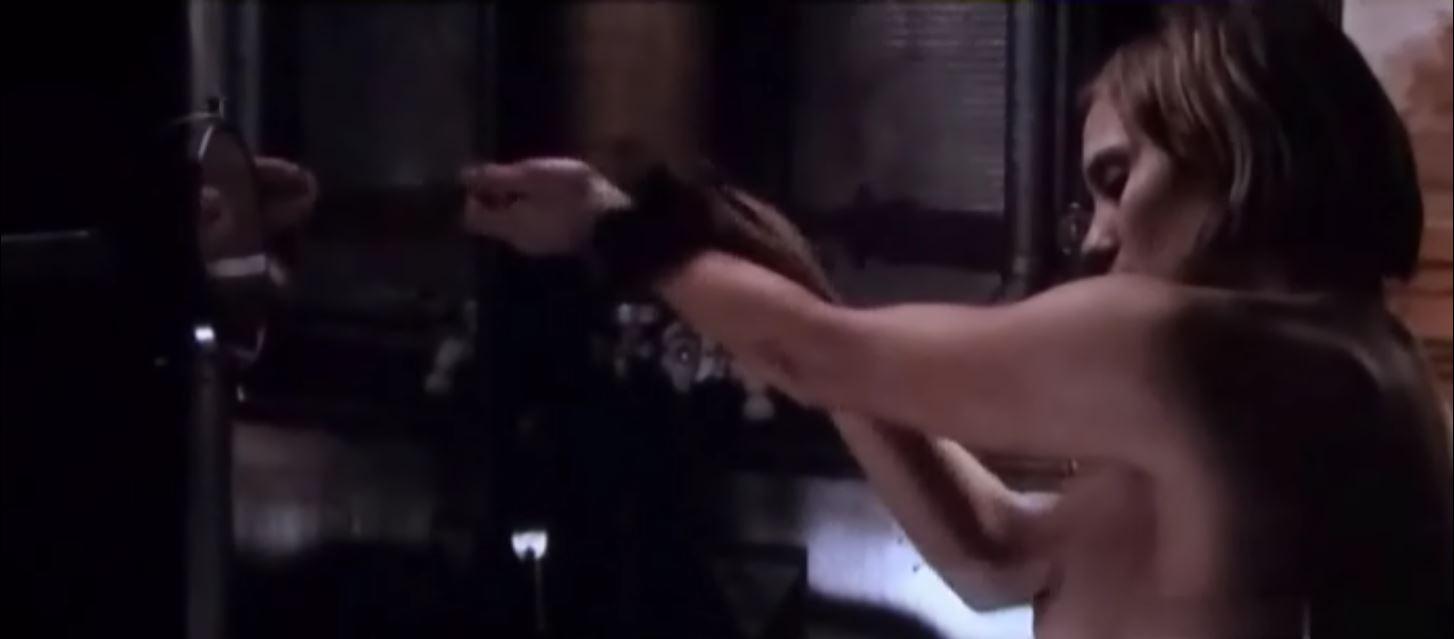 Katee Sackhoff topless sideboob in riddick 6