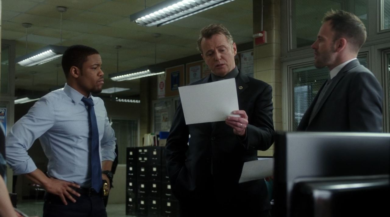 Elementary S2E19 The Many Mouths of Aaron Colville - Bell, Gregson and Sherlock reviewing the case