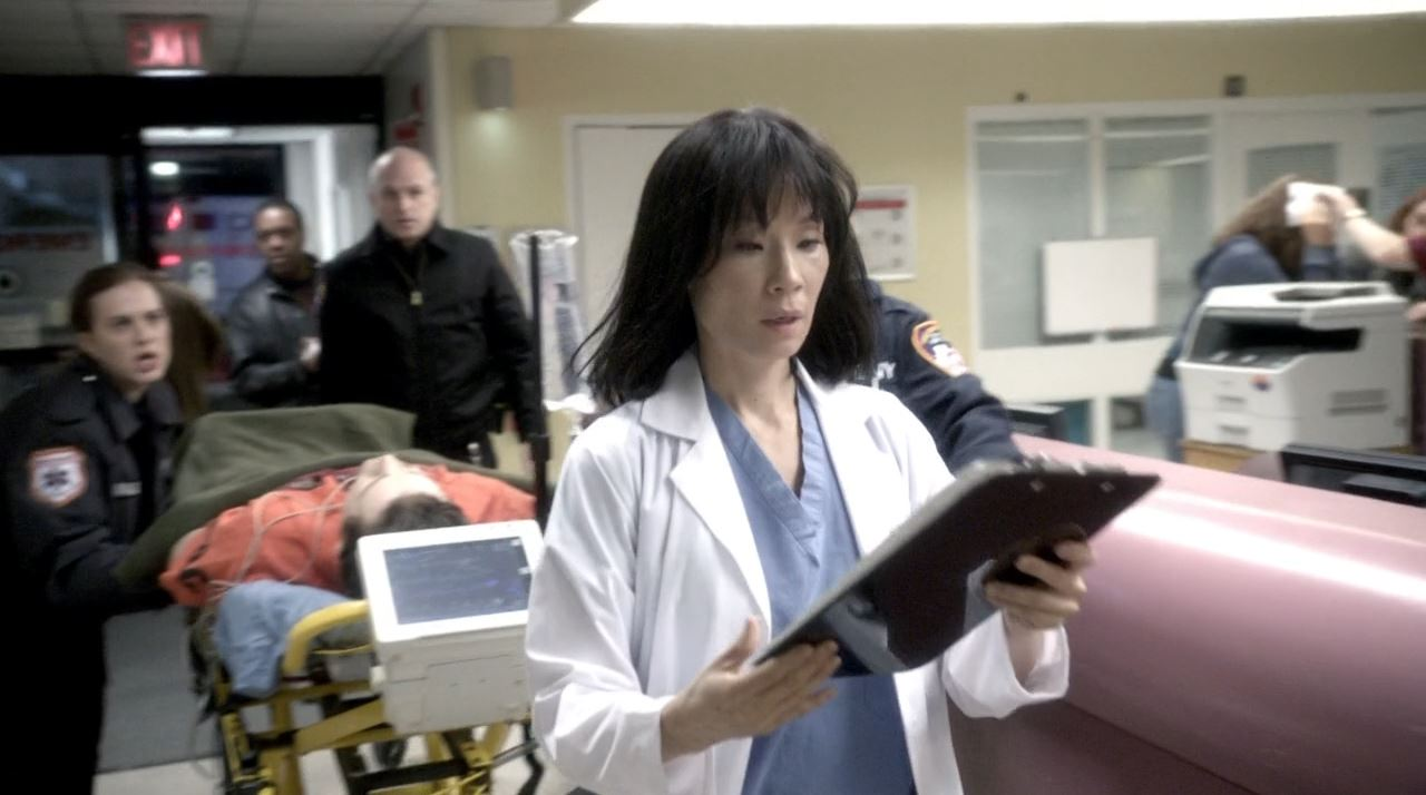 Elementary S2E19 The Many Mouths of Aaron Colville - Watson (Lucy Lui) in 2005