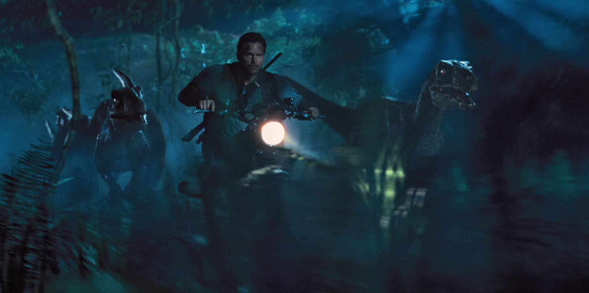 Owen Grady (Chris Pratt) chasing raptors - Jurassic World Review