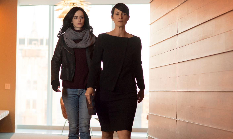 Carrie-Anne Moss as Jeri Holgrath and Krysten Ritter as Jessica Jones