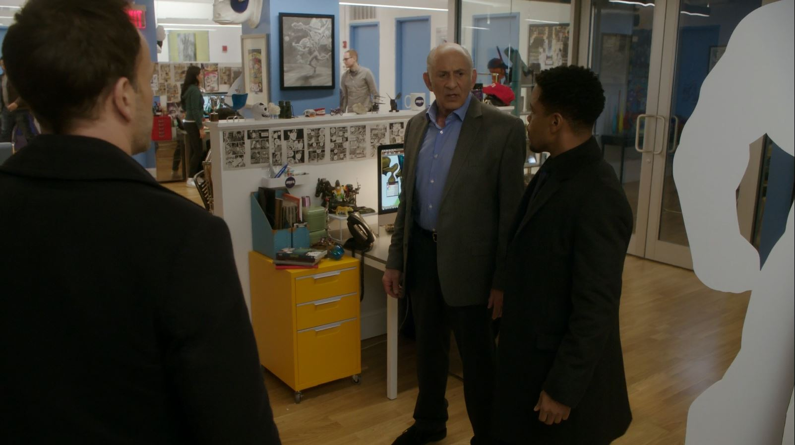 Sherlock and Marcus evacuate the comic book publisher. Elementary S4Ep17