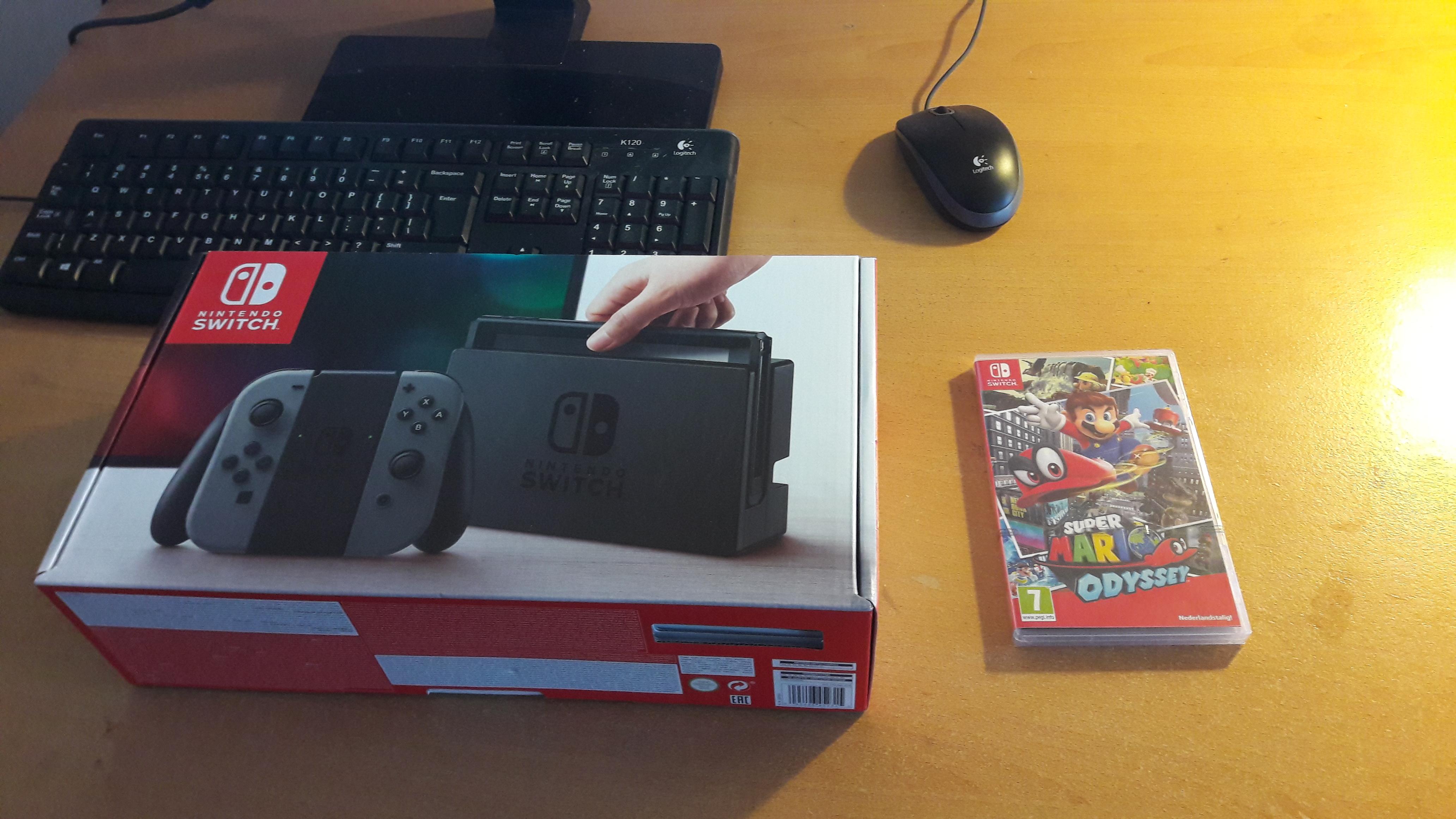 Nintendo Switch box and Super Mario Odyssey