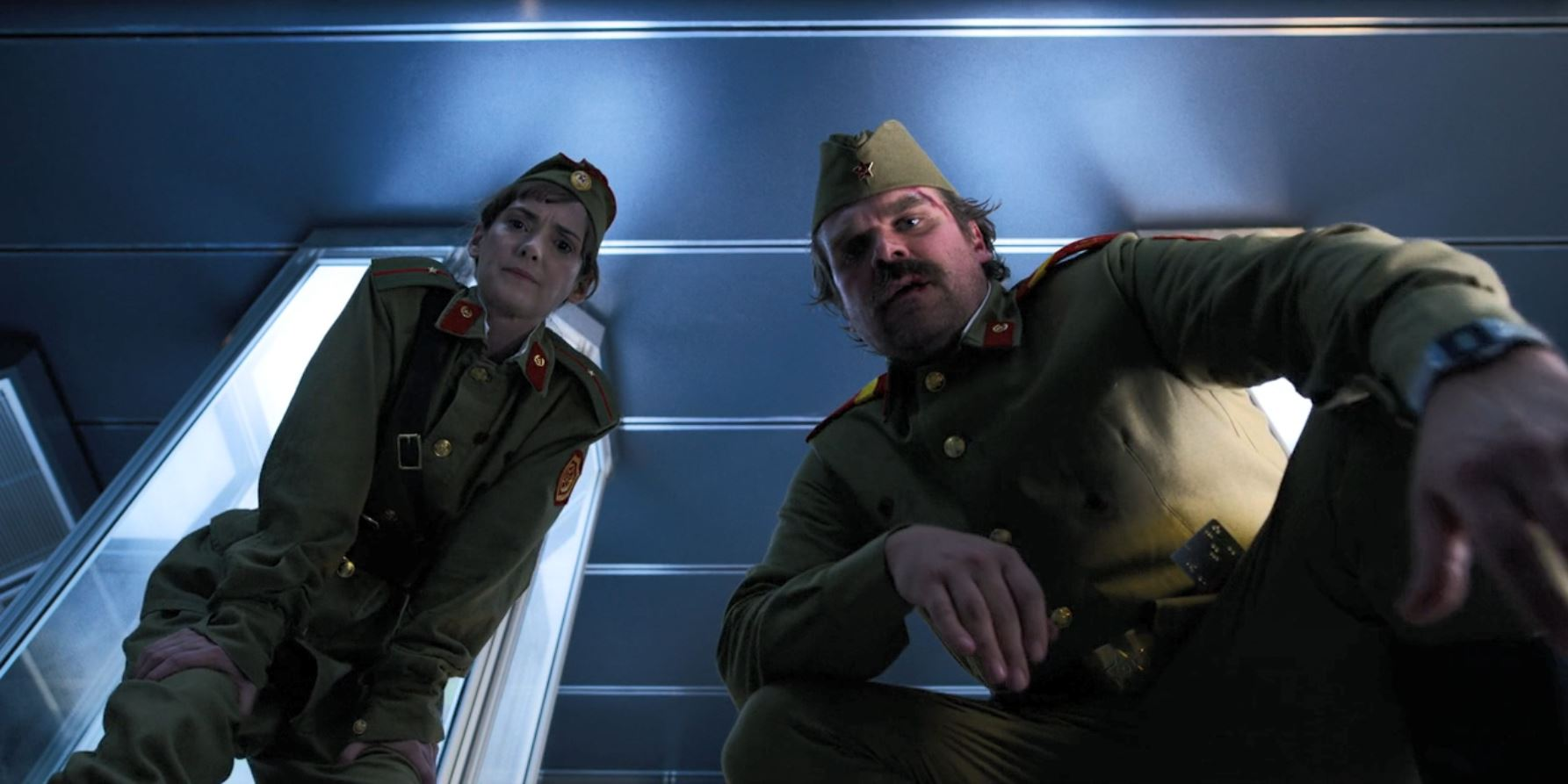 Stranger Things Season 3 Review - Jim and Joyce in Russian uniforms