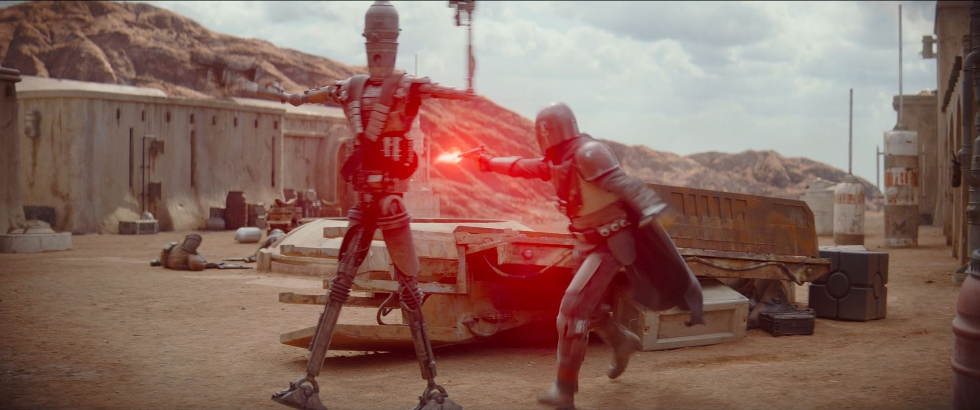 The Mandalorian and IG-11 fight their way through the compound